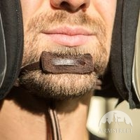 Chin strap with a drawstring and toggle
